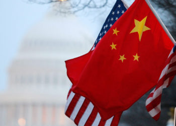 The People's Republic of China flag and the U.S. Stars and Stripes fly along Pennsylvania Avenue near the U.S. Capitol in Washington during Chinese President Hu Jintao's state visit, January 18, 2011. Hu arrived in the United States on Tuesday for a state visit with U.S. President Barack Obama that is aimed at strengthening ties between the world's two biggest economies. REUTERS/Hyungwon Kang (UNITED STATES - Tags: POLITICS)